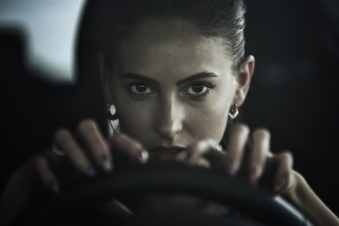 © Simba3003 | Dreamstime.com - Dangerous Beauty Woman Driving A Car, Close Up Portrait Photo